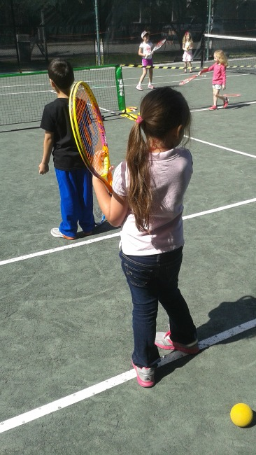 Isabella and Joaquin playing tennis at the Delray Beach Open Kidz Day